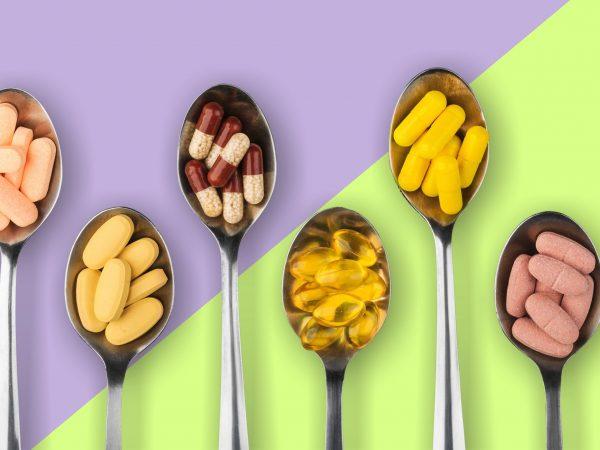 Healthy supplements on teaspoons